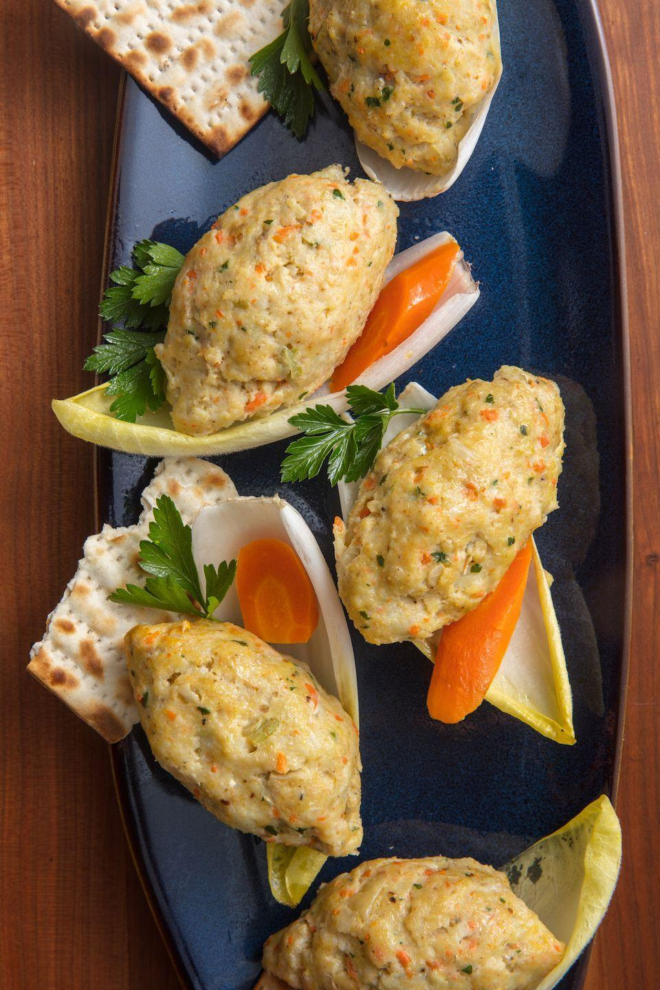 """<p>According to Jewish dietary laws, fish is allowed to be eaten with both dairy and meat meals (though the two can't be eaten with each other). Hence the ubiquity of </p><p>Get the recipe from <a href=""""https://www.delish.com/cooking/recipe-ideas/a19473685/gefilte-fish-recipe/"""" rel=""""nofollow noopener"""" target=""""_blank"""" data-ylk=""""slk:Delish"""" class=""""link rapid-noclick-resp"""">Delish</a>. </p>"""