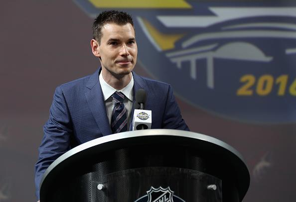 "John Chayka of the <a class=""link rapid-noclick-resp"" href=""/nhl/teams/ari/"" data-ylk=""slk:Arizona Coyotes"">Arizona Coyotes</a> speaks at the podium during round one of the 2016 NHL Draft at First Niagara Center on June 24, 2016 in Buffalo, New York. (Getty Images)"