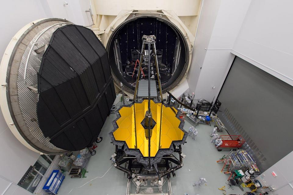 The assembled telescope being wheeled out of a large chamber.
