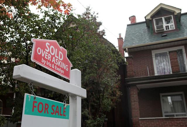 "A ""Sold over asking"" sign is on display on a house for sale in Toronto's housing market Oct. 21, 2016. (HuffPost CA)"