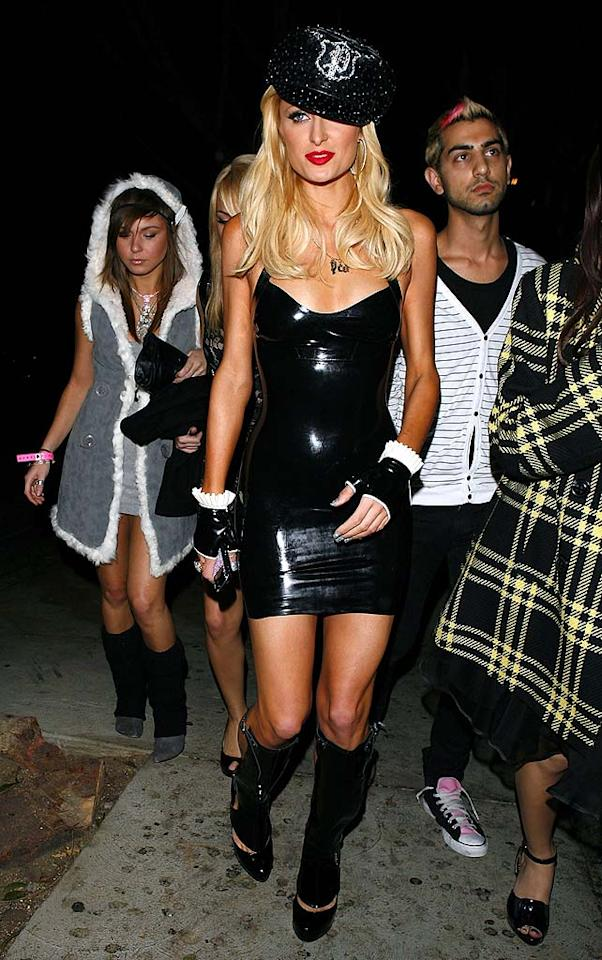 """Dear Paris, Halloween was like last month. Therefore, your bedazzled cop cap, latex mini, fingerless gloves, and shin guards look beyond ridiculous. Jean Baptiste Lacroix/<a href=""""http://www.wireimage.com"""" target=""""new"""">WireImage.com</a> - November 23, 2008"""