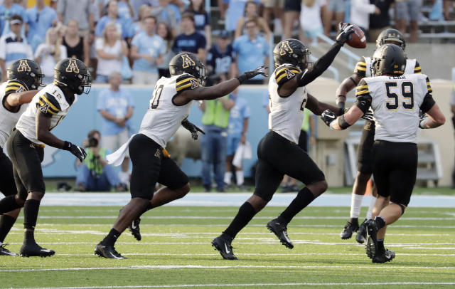 Appalachian State's Akeem Davis-Gaither (24) celebrates his interception against North Carolina during the third quarter of an NCAA college football game in Chapel Hill, N.C., Saturday, Sept. 21, 2019. (AP Photo/Chris Seward)