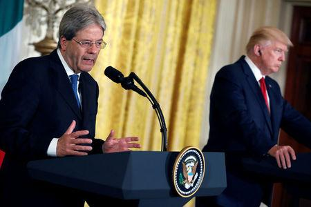 U.S. President Donald Trump holds a joint news conference with Italian Prime Minister Paolo Gentiloni at the White House in Washington