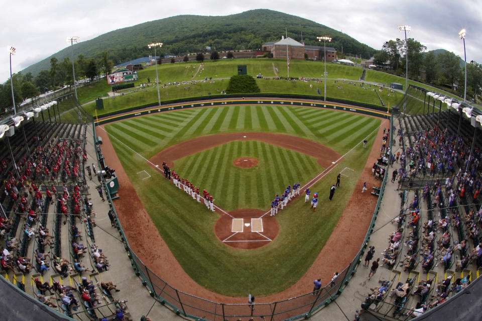 Hamilton, Ohio, lines the third base line and Taylor, Mich., line up on the first base line during player introductions before the Little League World Series Championship baseball game at Lamade Stadium in South Williamsport, Pa., Sunday, Aug. 29, 2021. (AP Photo/Gene J. Puskar)