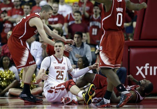 Maryland center Alex Len, of Ukraine, (25) and North Carolina State forward Richard Howell, bottom right, react after Len received an offensive foul call as he drove into Howell in the first half of an NCAA college basketball game in College Park, Md., Wednesday, Jan. 16, 2013. (AP Photo/Patrick Semansky)