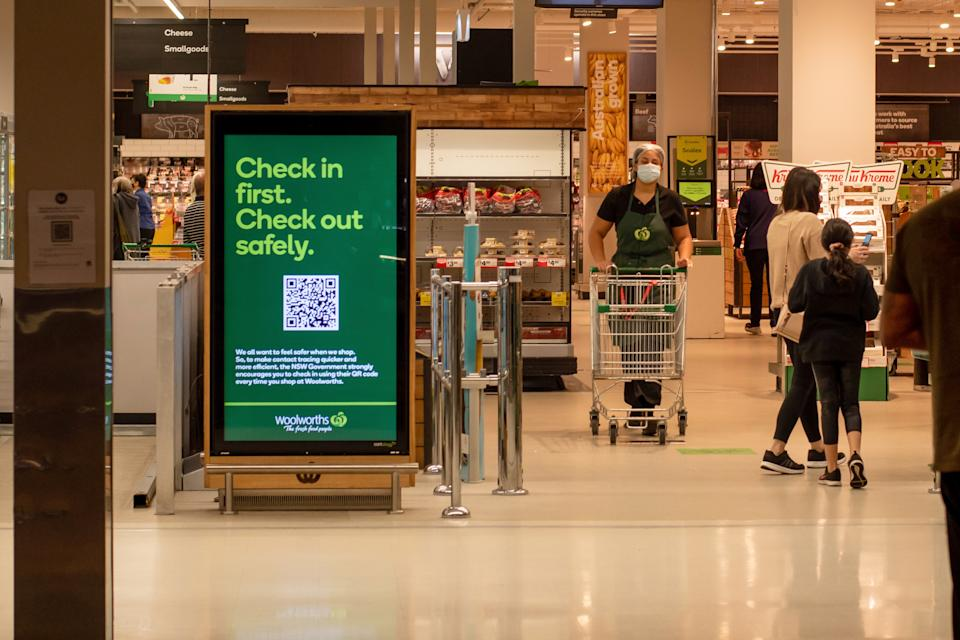 A check-in sign at the front of a Woolworths store. Source: Getty Images