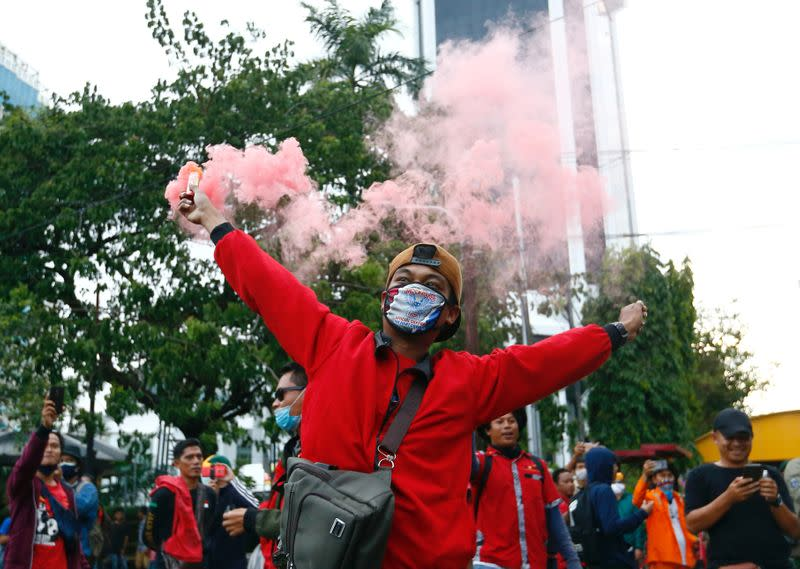 FILE PHOTO: Trade union members protest against government's labor reforms in Jakarta
