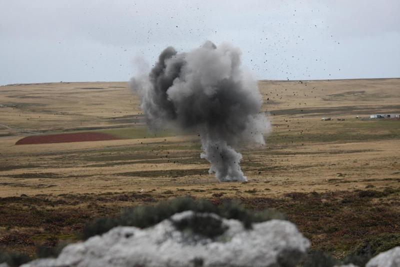 A land mine explodes in the distance (Robert Fox)