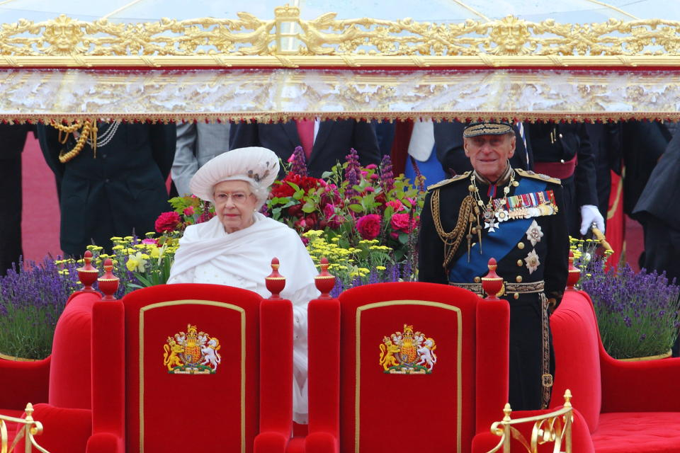 Queen Elizabeth II and Prince Philip aboard the Royal Barge Spirit of Chartwell heads the historic flotilla of 1000 boats along the Thames river past the Houses of Parliament and Big Ben to commemorate her 60th anniversary of the accession of Queen, London. 3 June 2012 --- Image by �� Paul Cunningham/Corbis (Photo by Paul Cunningham/Corbis via Getty Images)