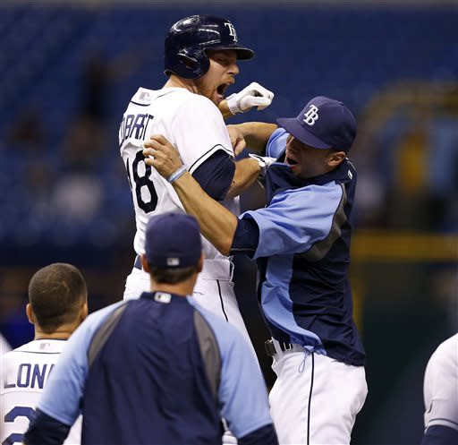 Tampa Bay Rays' Ben Zobrist (18) celebrates with teammate Sean Rodriguez after driving in the game-winning run in the bottom of the 13th inning of a baseball game against the Minnesota Twins Wednesday, July 10, 2013, in St. Petersburg, Fla. The Rays won 4-3.(AP Photo/Mike Carlson)