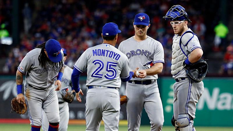 Toronto Blue Jays manager Charlie Montoyo (25) takes the ball from relief pitcher Thomas Pannone, center, right. (AP Photo/Tony Gutierrez)