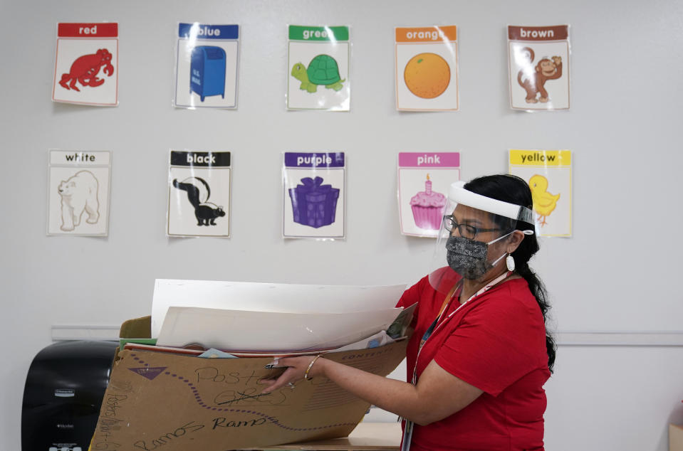 "Kindergarten teacher Judith Ramos prepares her classroom on Aug. 13 in San Antonio. The White House has now declared teachers ""essential workers."" (Eric Gay/AP)"