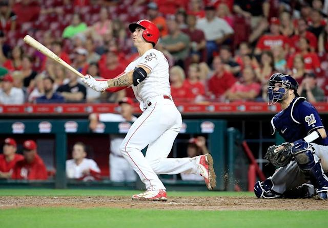 Cincinnati Reds reliever Michael Lorenzen follows through on his fourth home run of the season during Wednesday's game against the Milwaukee Brewers. (Getty Images)