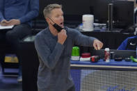 Golden State Warriors coach Steve Kerr gestures during the first half of the team's NBA basketball game against the Indiana Pacers in San Francisco, Tuesday, Jan. 12, 2021. (AP Photo/Jeff Chiu)