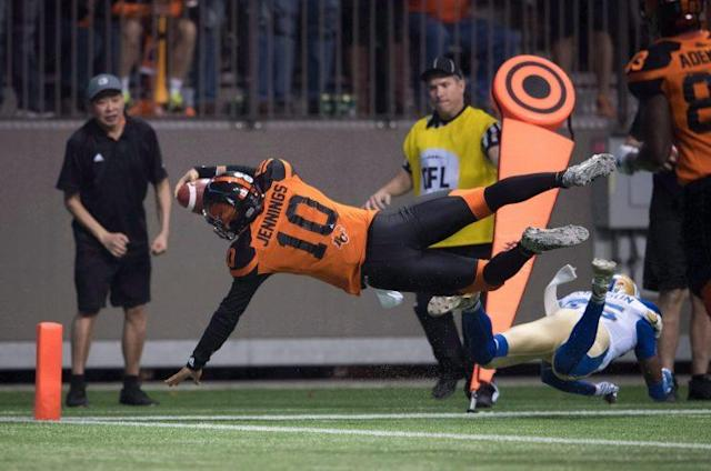 <em>B.C. Lions quarterback Jonathon Jennings dives into the end zone for the winning touchdown against Winnipeg on Nov. 13, 2016. (THE CANADIAN PRESS/Darryl Dyck Photo)</em>