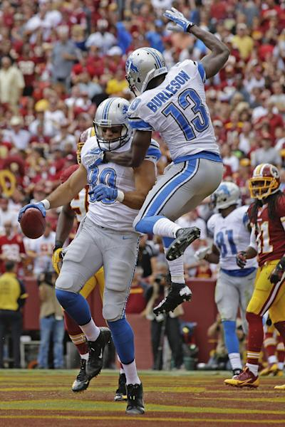 Detroit Lions tight end Joseph Fauria celebrates his touchdown reception with wide receiver Nate Burleson (13) during the first half of a NFL football game against the Washington Redskins in Landover, Md., Sunday, Sept. 22, 2013. (AP Photo/Alex Brandon)
