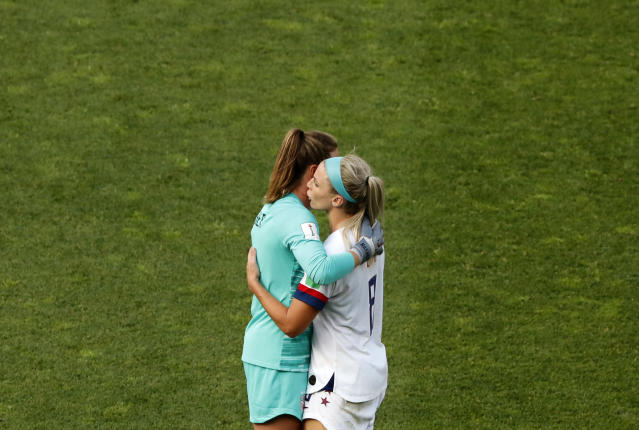 United States goalkeeper Alyssa Naeher, left, and Julie Ertz celebrate at the end of the Women's World Cup round of 16 soccer match between Spain and United States at Stade Auguste-Delaune in Reims, France, Monday, June 24, 2019. (AP Photo/Thibault Camus)