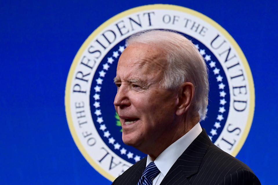 President Biden delivers remarks before signing an executive order at the White House on Monday. (Jim Watson/AFP via Getty Images)