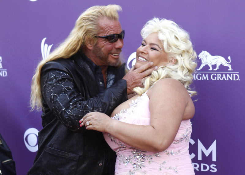 Duane and Beth Chapman arrive at the 48th ACM Awards in Las Vegas, April 7, 2013. REUTERS/Steve Marcus (UNITED STATES - Tags: ENTERTAINMENT)
