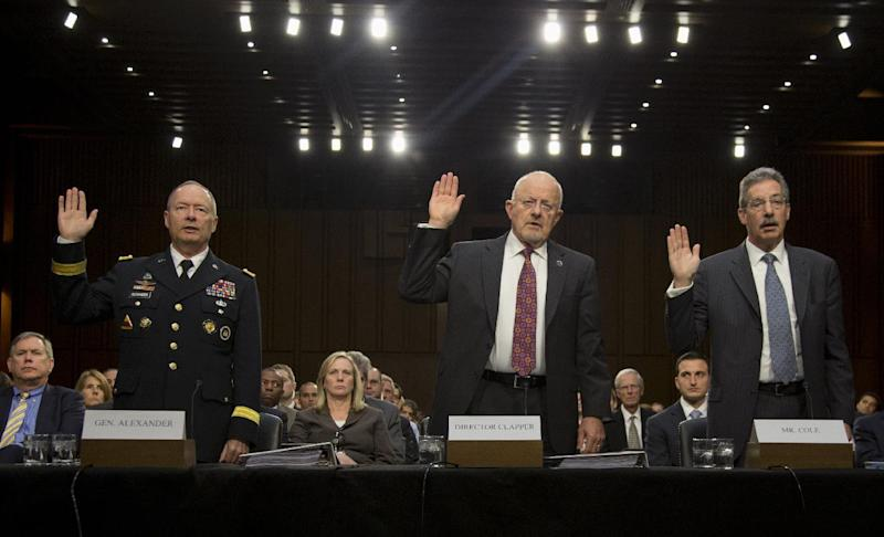 From left, National Security Agency Director General Keith Alexander, Director of National Intelligence James Clapper, and Deputy Attorney General James Cole are sworn in on Capitol Hill in Washington, Thursday, Sept. 26, 2013, prior to testifying before the Senate Intelligence Committee hearing on the Foreign Intelligence Surveillance Act (FISA), and National Security Agency (NSA) call records. (AP Photo/Carolyn Kaster)