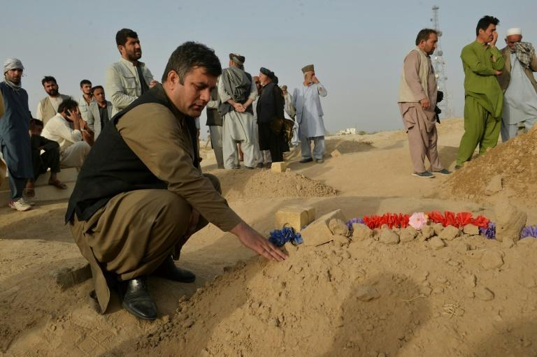 Relatives and friends mourn the victims of the attack, which was claimed by the Islamic State-Khorasan group -- locals say scores were killed (AFP/Hoshang Hashimi)