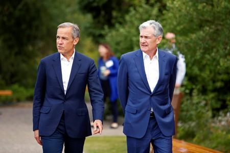 """Federal Reserve Chair Jerome Powell and Governor of the Bank of England, Mark Carney are seen during the three-day """"Challenges for Monetary Policy"""" conference in Jackson Hole, Wyoming"""