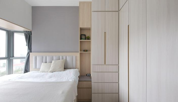 With custom millwork, storage is packed into the main bedroom.