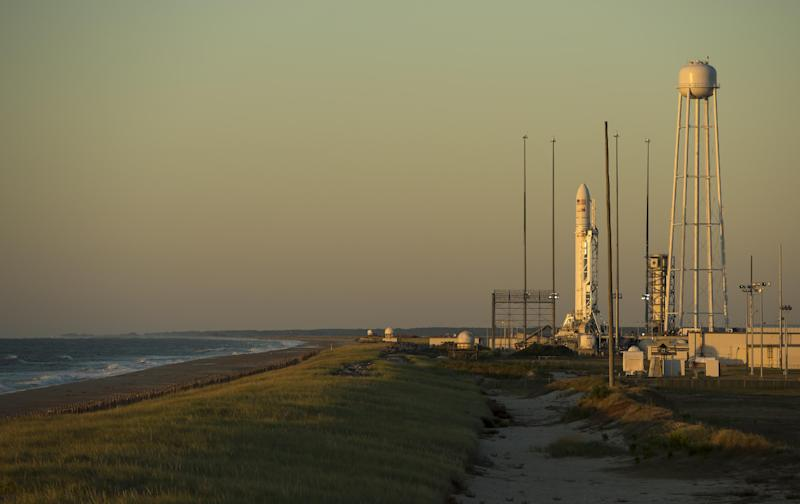 The Orbital Sciences Corporation Antares rocket, with its Cygnus cargo spacecraft aboard, is seen at sunrise Tuesday, Sept. 17, 2013 on the Mid-Atlantic Regional Spaceport (MARS) Pad-0A at the NASA Wallops Flight Facility, in Wallops Island, Va. NASA's commercial space partner, Orbital Sciences Corporation, is targeting a Sept. 18 launch for its demonstration cargo resupply mission to the International Space Station. (AP Photo/NASA, Bill Ingalls)