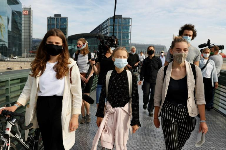 """Luisa Neubauer, Greta Thunberg and Adelaide Charlier (left to right) head to meeting with Merkel warning """"we are still in a state of denial"""" on global warming"""