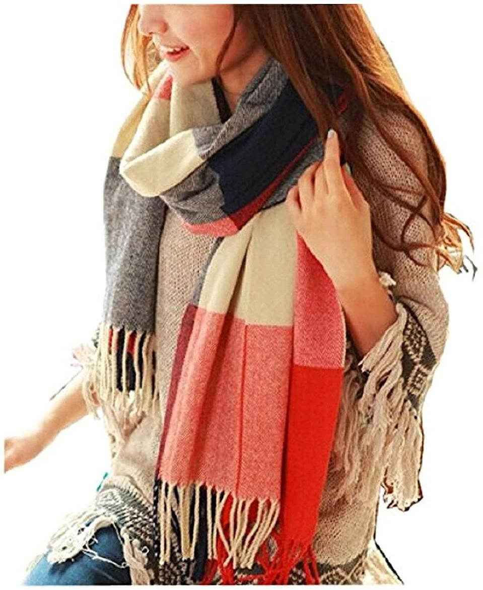<p>Wrap yourself up in this <span>Loritta Plaid Scarf</span> ($13).</p>