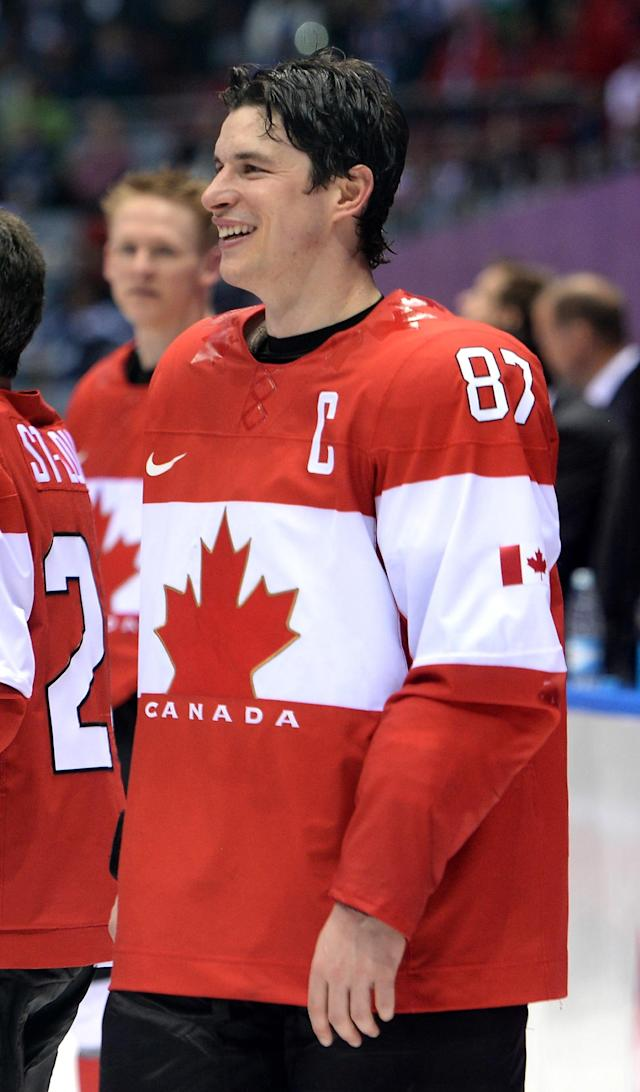 SOCHI, RUSSIA - FEBRUARY 23: Sidney Crosby #87 of Canada celebrates prior to receiving the gold medal won during the Men's Ice Hockey Gold Medal match against Sweden on Day 16 of the 2014 Sochi Winter Olympics at Bolshoy Ice Dome on February 23, 2014 in Sochi, Russia. (Photo by Harry How/Getty Images)