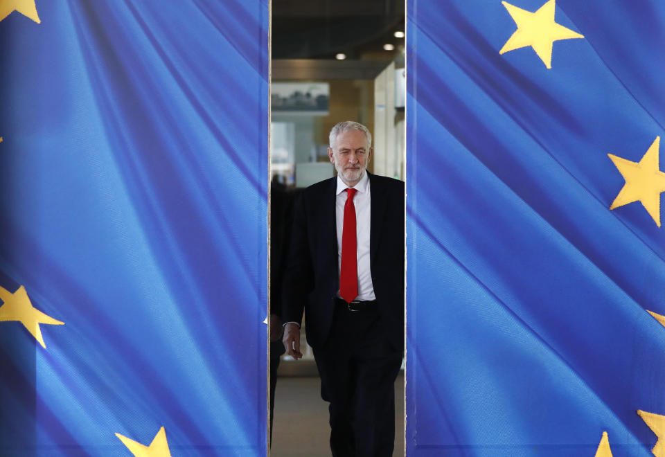 British Labour Party leader Jeremy Corbyn leaves EU headquarters prior to an EU summit in Brussels, Thursday, March 21, 2019. British Prime Minister Theresa May is trying to persuade European Union leaders to delay Brexit by up to three months, just eight days before Britain is scheduled to leave the bloc. (AP Photo/Frank Augstein)