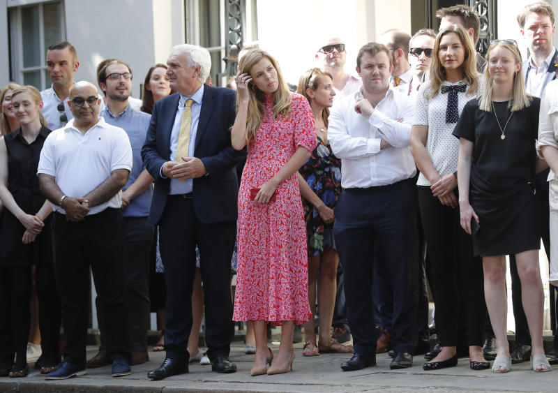 Carrie Symonds, center, the girlfriend of Britain's new Prime Minister Boris Johnson waits in 10 Downing Street, London, Wednesday, July 24, 2019. Boris Johnson has replaced Theresa May as Prime Minister, following her resignation last month after Parliament repeatedly rejected the Brexit withdrawal agreement she struck with the European Union. (AP Photo/Frank Augstein)