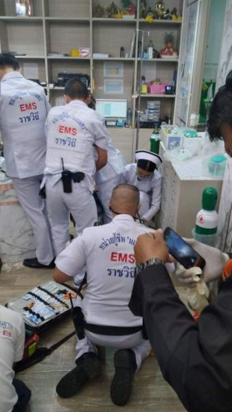 Emergency services are seen inside a cosmetic clinic after a shooting at a shopping mall in Bangkok