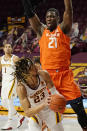 Minnesota's Brandon Johnson (23) eyes the basket as Illinois' Kofi Cockburn (21) hovers over him in the first half of an NCAA college basketball game, Saturday, Feb. 20, 2021, in Minneapolis. (AP Photo/Jim Mone)