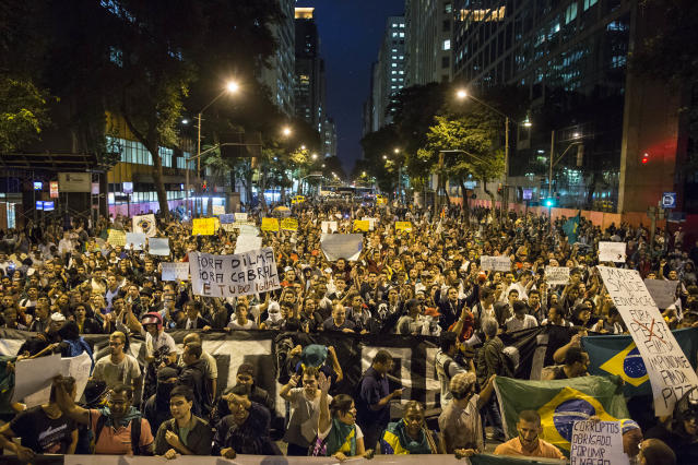 People march toward the Cinelandia square during a protest in Rio de Janeiro, Brazil, Monday, June 24, 2013. Under pressure after more than a week of nationwide protests, Brazilian leader Dilma Rousseff said Monday her government will spend $23 billion more on public transportation and announced five core areas that leaders will focus on to speed political reform and improvements to government services. Rousseff made the announcement after meeting with leaders of a free-transit activist group that launched the first demonstrations more than a week ago and has called for new protests Tuesday.(AP Photo/Felipe Dana)(AP Photo/Felipe Dana)