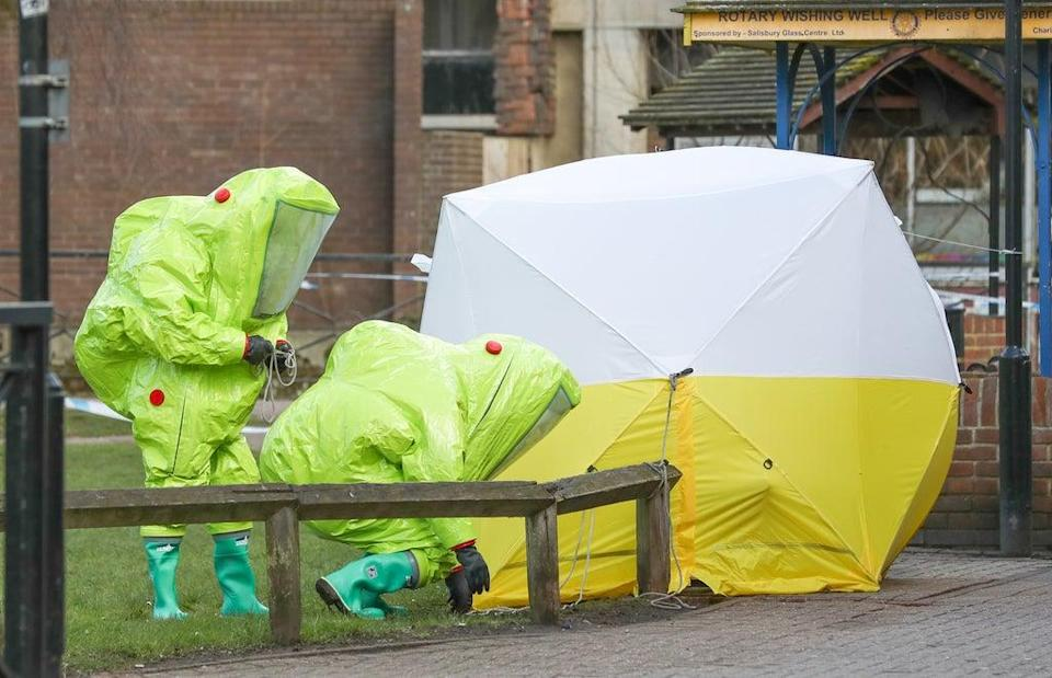 File photo dated 08/03/18 of personnel in hazmat suits working to secure a tent covering a bench in the Maltings shopping centre in Salisbury, where former Russian double agent Sergei Skripal and his daughter Yulia, were found critically ill by exposure to Novichok nerve agent. A third Russian spy faces charges of attempted murder over the Salisbury Novichok poisonings. (Andrew Matthews/PA) Issue date: Tuesday September 21, 2021. (PA Wire)