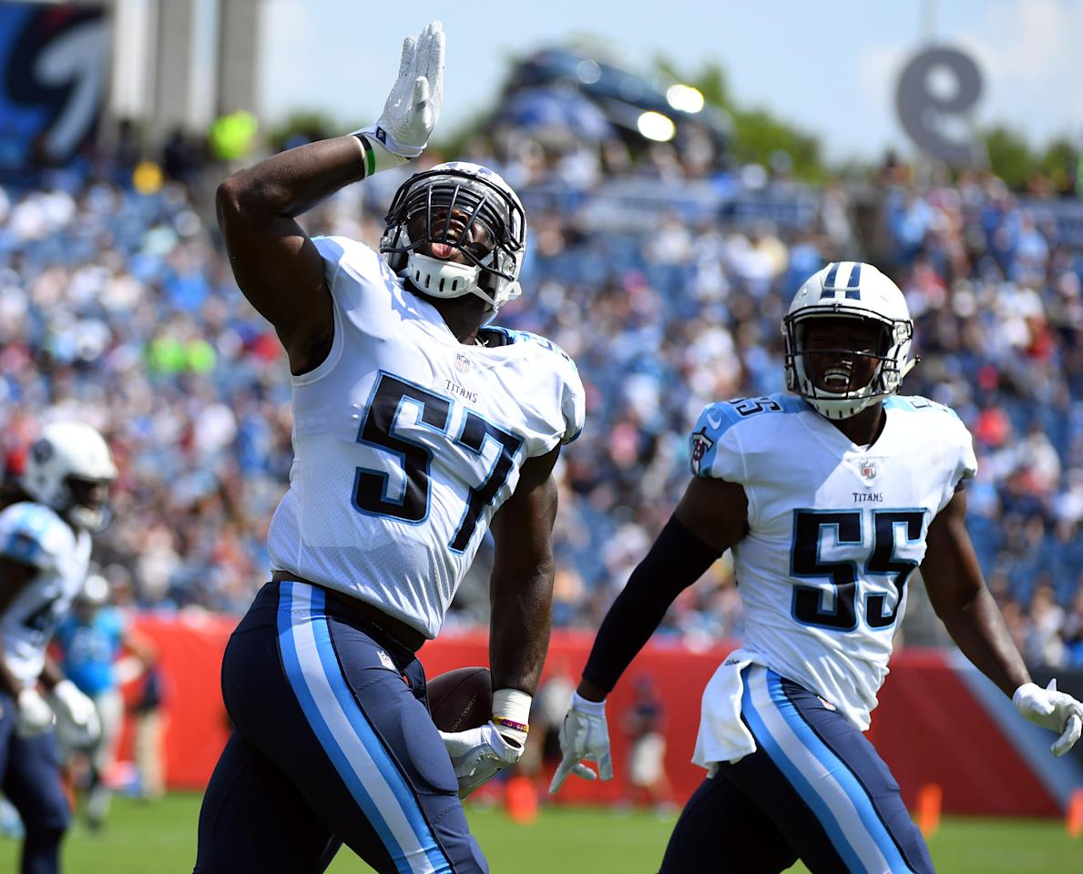 Aug 19, 2017; Nashville, TN, USA; Tennessee Titans linebacker Justin Staples (57) celebrates after an interception during the first half against the Carolina Panthers at Nissan Stadium. Mandatory Credit: Christopher Hanewinckel-USA TODAY Sports     TPX IMAGES OF THE DAY