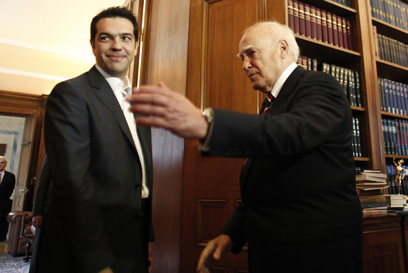 Greek President Karolos Papoulias, right, meets with with leader of Coalition of the Radical Left party (SYRIZA) Alexis Tsipras to formally give him the mandate to form a coalition government in Athens, on Tuesday, May 8, 2012. Bailout-reliant Greece faces days, possibly weeks, of political instability after voters angry at crippling income cuts punished mainstream politicians, let a far-right extremist group into Parliament but gave no party enough votes to govern alone. (AP Photo/Kostas Tsironis, pool)