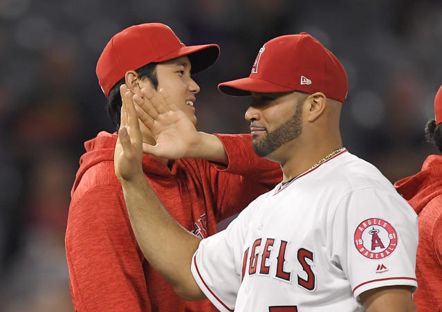 Los Angeles Angels' Shohei Ohtani, left, of Japan, congratulates Albert Pujols after the Angels defeated the Toronto Blue Jays 8-5 in a baseball game Thursday, June 21, 2018, in Anaheim, Calif. (AP Photo/Mark J. Terrill)