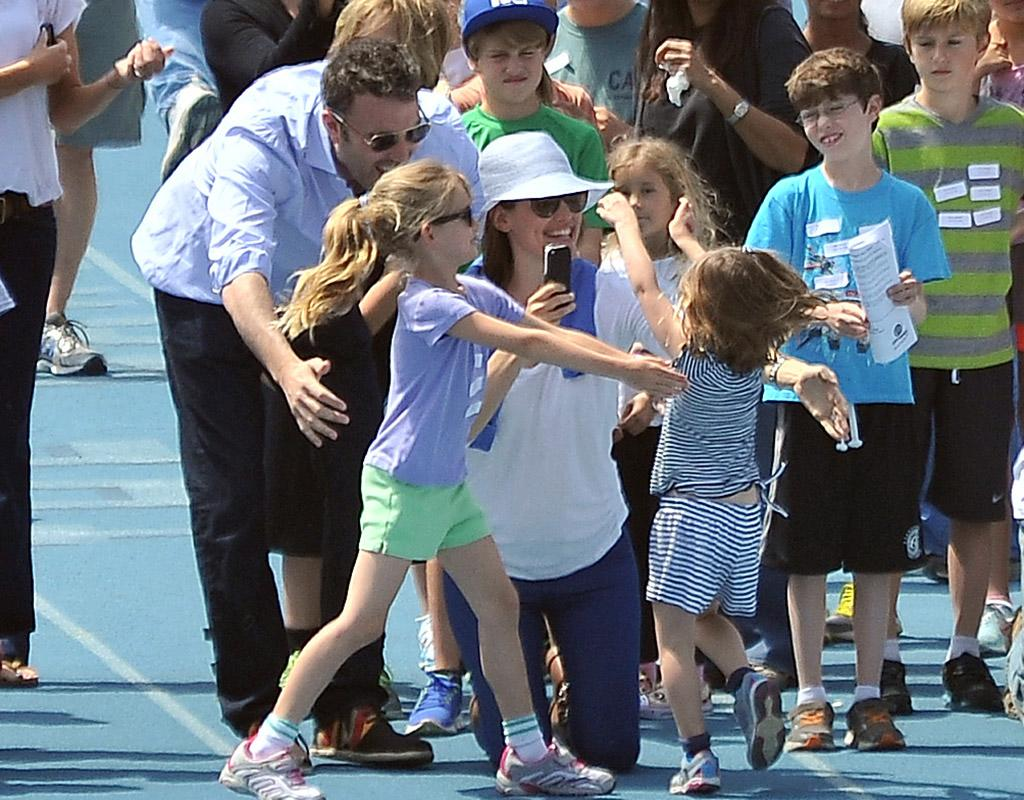Ben Affleck, Jennifer Garner, and their 7-year-old daughter Violet were all on hand with hugs to greet youngest daughter, 4-year-old Seraphina (in stripes), on Sunday as she finished a race in Pacific Palisades, California. (4/28/2013)