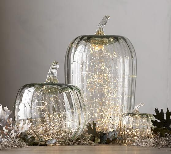 """<p>The <a href=""""https://www.popsugar.com/buy/Recycled-Glass-Pumpkin-Cloche-480549?p_name=Recycled%20Glass%20Pumpkin%20Cloche&retailer=potterybarn.com&pid=480549&price=16&evar1=casa%3Aus&evar9=46504162&evar98=https%3A%2F%2Fwww.popsugar.com%2Fphoto-gallery%2F46504162%2Fimage%2F46504166%2FRecycled-Glass-Pumpkin-Cloche&list1=shopping%2Challoween%2Cpottery%20barn%2Challoween%20decor%2Chome%20shopping&prop13=api&pdata=1"""" rel=""""nofollow"""" data-shoppable-link=""""1"""" target=""""_blank"""" class=""""ga-track"""" data-ga-category=""""Related"""" data-ga-label=""""https://www.potterybarn.com/products/recycled-glass-pumpkin-candle-cloche/?pkey=s%7Challoween%20decor%7C134"""" data-ga-action=""""In-Line Links"""">Recycled Glass Pumpkin Cloche</a> ($16-$55, originally $20-$69) is handcrafted so that each one you receive has a unique touch.</p>"""
