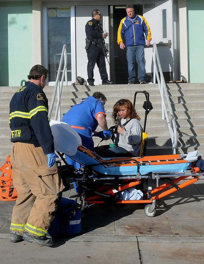 This image provided by the Taft Midway Driller/Doug Keeler shows paramedics assisting a student wounded during a shooting Thursday Jan. 10, 2013 at San Joaquin Valley high school in Taft, Calif. Authorities said a student was shot and wounded and another student was taken into custody. (AP Photo/Taft Midway Driller, Doug Keeler) MANDATORY CREDIT