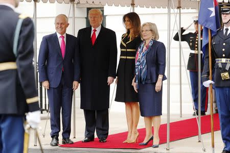 U.S. President Donald Trump and first lady Melania Trump welcome Australian Prime Minister Malcolm Turnbull (L) and Lucy Turnbull (R) to the White House in Washington, U.S., February 23, 2018. REUTERS/Jonathan Ernst