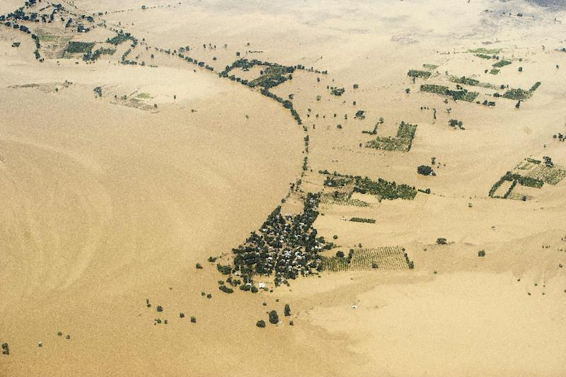 An aerial view shows floodwaters inundating houses and vegetation in Kalay, upper Myanmar's Sagaing region, on August 2, 2015 (AFP Photo/Ye Aung Thu)