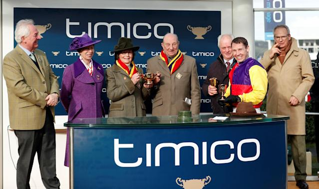 Horse Racing - Cheltenham Festival - Cheltenham Racecourse, Cheltenham, Britain - March 16, 2018 Richard Johnson celebrates with the team and Princess Anne after riding Native River to victory in the 15.30 Timico Cheltenham Gold Cup Chase Action Images via Reuters/Andrew Boyers
