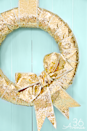 """<p>Give your Christmas porch a dose of major pizazz with glittering golden decor. Try the hue in a wreath, garlands, ornaments, seating accessories — wherever you can tuck in a little glamour. <br></p><p><strong><em>Get the look at <a href=""""https://www.the36thavenue.com/christmas-wreath-tutorial/"""" rel=""""nofollow noopener"""" target=""""_blank"""" data-ylk=""""slk:Desiree Campbell"""" class=""""link rapid-noclick-resp"""">Desiree Campbell</a>.</em></strong> </p>"""