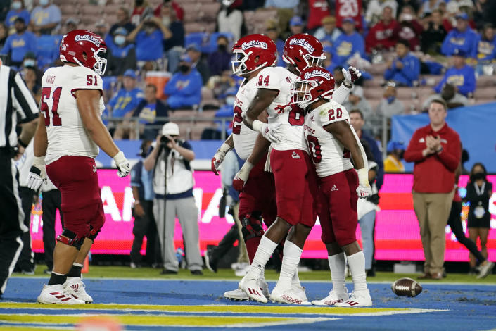 Fresno State running back Ronnie Rivers (20) celebrates his rushing touchdown with teammates during the first half of an NCAA college football game against UCLA on Saturday, Sept. 18, 2021, in Pasadena, Calif. (AP Photo/Marcio Jose Sanchez)