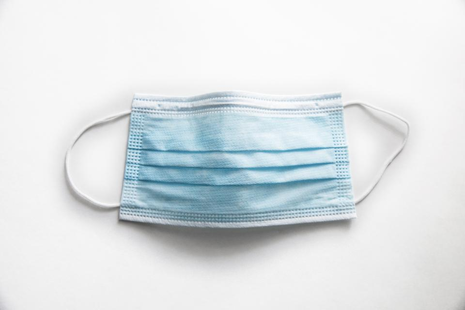 Surgical mask on white background