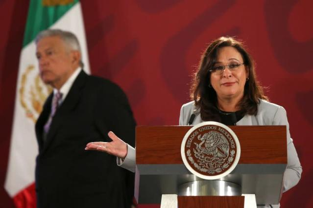 FILE PHOTO: Mexico's Energy Minister Rocio Nahle gestures next Mexico's President Andres Manuel Lopez Obrador during a news conference at the National Palace in Mexico City